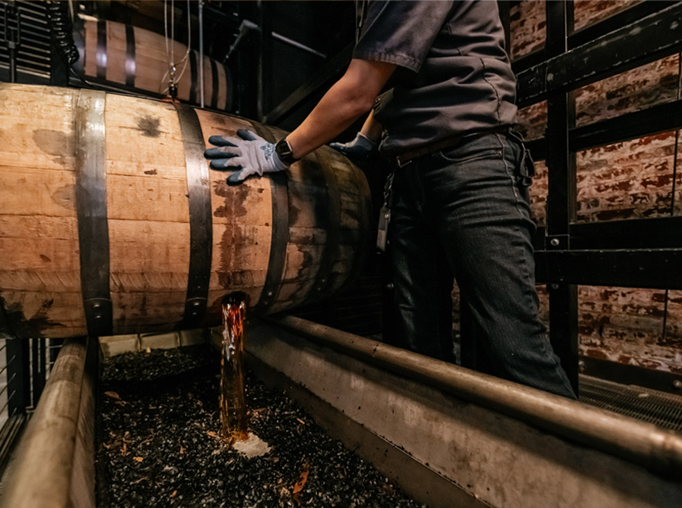 Old Forester Single Barrel Whisky pouring from barrel