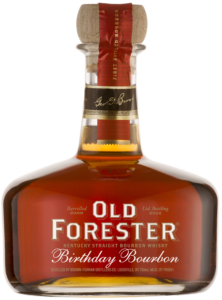 A bottle of Old Forester 2012 Birthday Bourbon on a black background.