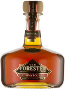 A bottle of Old Forester 2009 Birthday Bourbon on a black background.